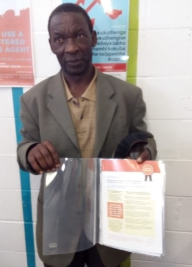 On 4 September 2019, Mr Cube received the title deed to his property in Khayelitsha. Image credit: Housing Finance Africa