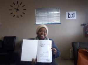 By 23 August 2019 the title deed was received and handed over to Mrs Mabuya. Image credit: Housing Finance Africa