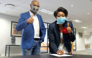 ortia Tau-Sekati CEO of the PSCC and Shawn Theunissen, Property Point's founder, sign MoU. Image credit: PSCC