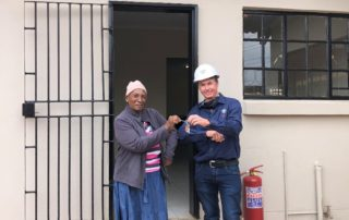 Chris Porter, Group Commercial Director, handed over the house to Marriam Mokhotho on 8 December 2020. Credit: M&D Construction