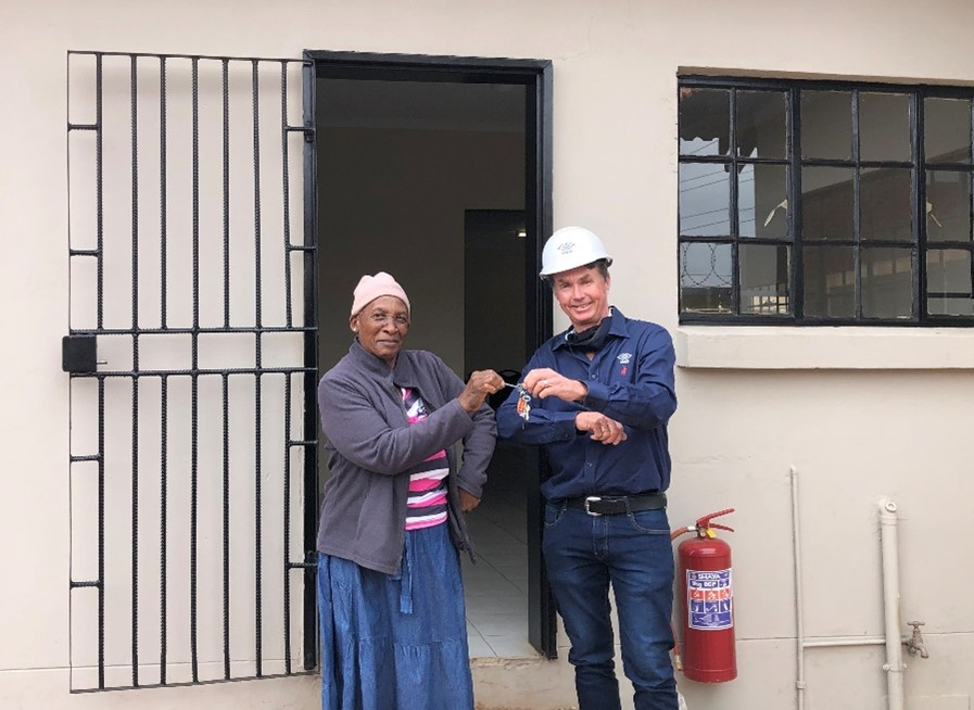 M&D Construction Group gives pensioner and her three sons a house that they can call home