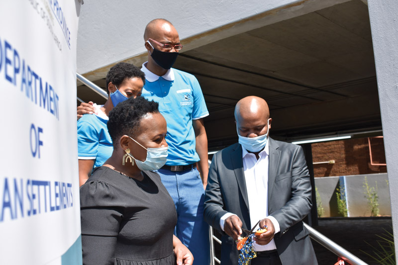 Official ribbon cutting ceremony by Gauteng MEC for Human Settlements, Lebogang Maile and watched by Ms Mahlengi Bhengu, Dr and Mrs Kula. Photo by © SA Affordable Housing   Rory Macnamara