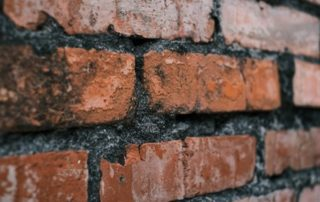 Even short technical skills courses like basic bricklaying, basic carpentry and so on – right down to training on how to use an angle grinder – are necessary, since the customer wants to see evidence that people are competent. Photo by Arawark chen | Unsplash