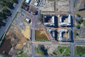 Aerial shot of the site, showing the public precinct starting to take shape, main entrance circle, town square and Heritage Precinct. Image by Concor